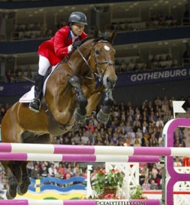 Beezie Madden and Simon winning the 2013 FEI Jumping World Cup Final (photo © Cealy Tetley)