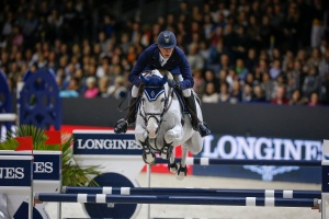Daniel Deusser of Germany and Cornet D'Amour take the 2014 Longines FEI World Cup Jumping title