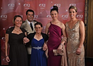 Charlotte Dujardin (right), wearing her Reem Acra dress, when she received the Reem Acra Best Athlete Award as one of five 2013 FEI Award winners. © FEI/Edouard Curchod